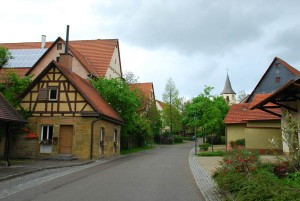 Village bake house at left and a view to the church of St. Nikolaus