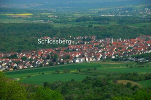 "A view of Dettingen from the ""Teck,"" a high hill to the east. The location of the ancestral area ""Schlossberg"" is indicated"