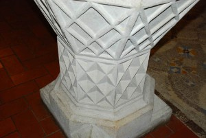 The 13th century font shows a three-sided triangle for the Holy Trinity and a four-sided triangle to represent the Four Elements of Fire, Air, Water and Earth