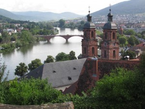 The view over the Main River and twin towers of St. Jakob Church