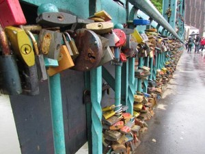 Padlocks, thousands of them, on a bridge in Wroclaw, Poland in the spring of 2013. Spreading pollution or cute devotion?