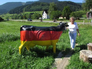 Gloria Temple with one of the cows seen throughout southern Germany. The farmers are protesting low milk prices.