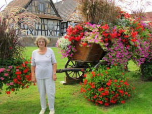 Gloria Temple and a beautiful old hay wagon with a new and colorful life