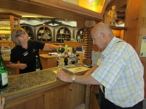 Ken Temple tastes a Muller Thurgau white wine in the Wine Cooperative's showroom in Durbach