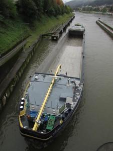 A huge empty barge waits its turn