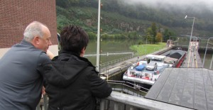 Jim and Denise watch a barge rising to the level of the river on the other side at Hirschhorn