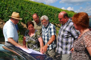 Professional researcher Roland Geiger, far left, shows members of Carl Tiedt's extended family in Veldenz plots of land where their ancestors grew grapes more than 125 years ago.