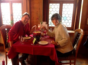 Tour guide James Derheim and Mariana enjoy their fondue lunch in Appenzell.