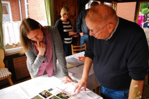 Marv Rosen looks at family photos and goes over genealogy with a relative at the Rosenwinkel home in Marklohe, Niedersachsen on September 28, 2014