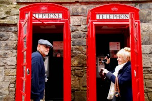 Having fun in a couple of the typical red phone booths near Edinburgh castle